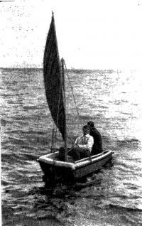 Лодка на ходу под парусом