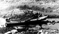 Перетаскивание лодки через мель
