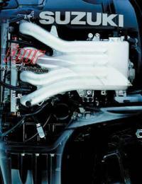 Четырехтактный мотор «Suzuki» со снятым капотом