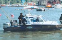 Лодка Рейо Лойко, капитана команды-победителя
