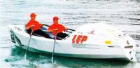 На веслах своей лодки Роб Хэмилл и Фил Стаббс